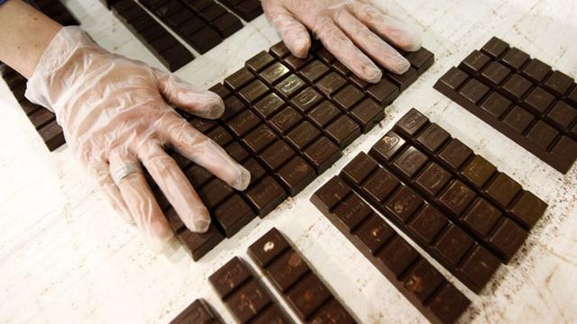 A worker checks the chocolates on a production line at Konya Seker Sugar Factory in Cumra